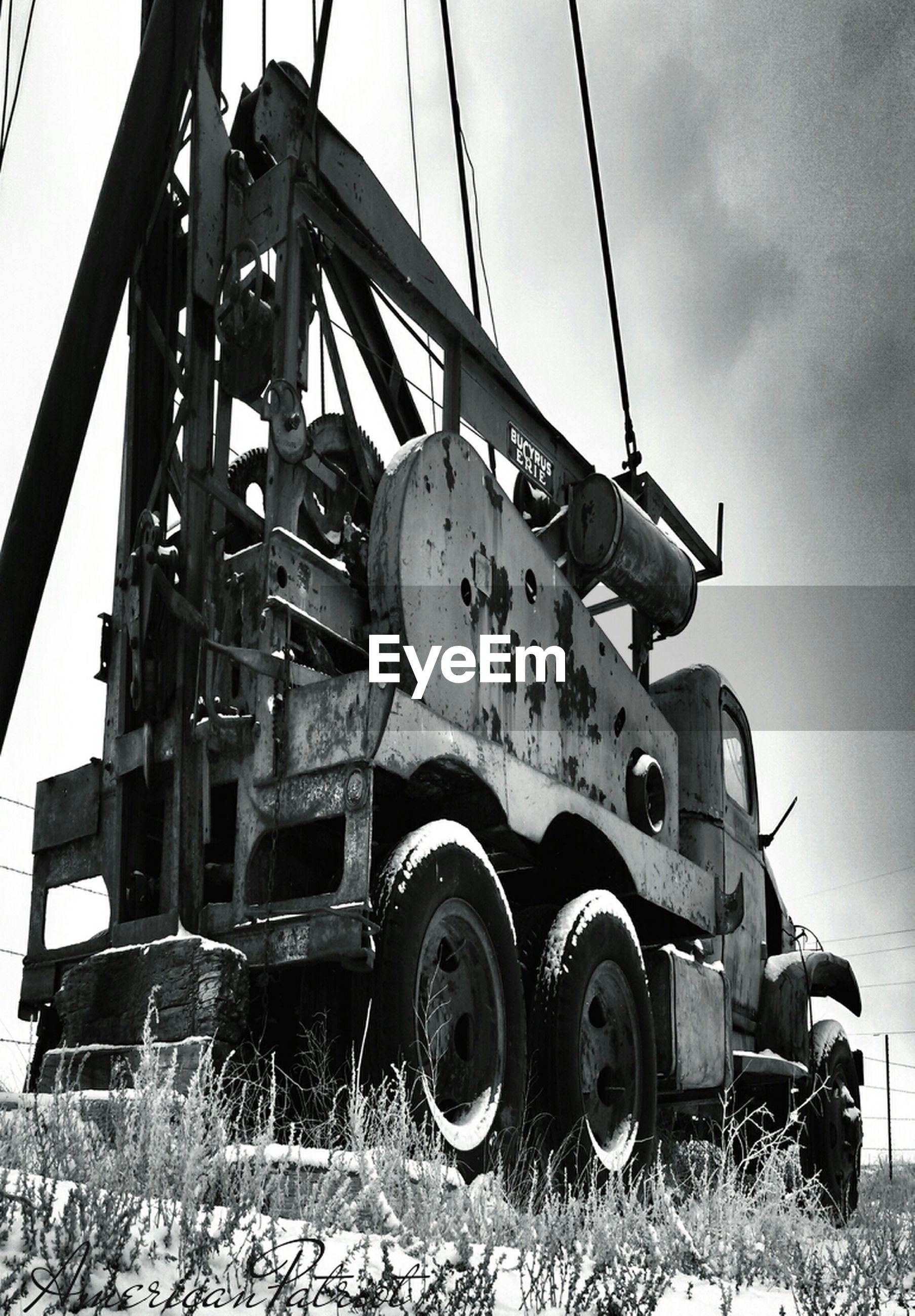 transportation, sky, metal, mode of transport, land vehicle, abandoned, low angle view, metallic, field, wheel, machinery, rusty, outdoors, built structure, day, obsolete, old, no people, clear sky, car