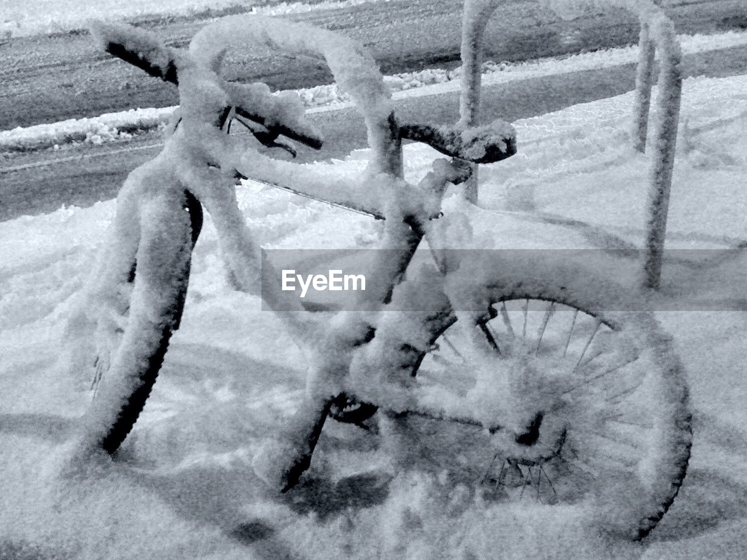 Frozen bicycle parked on footpath during winter