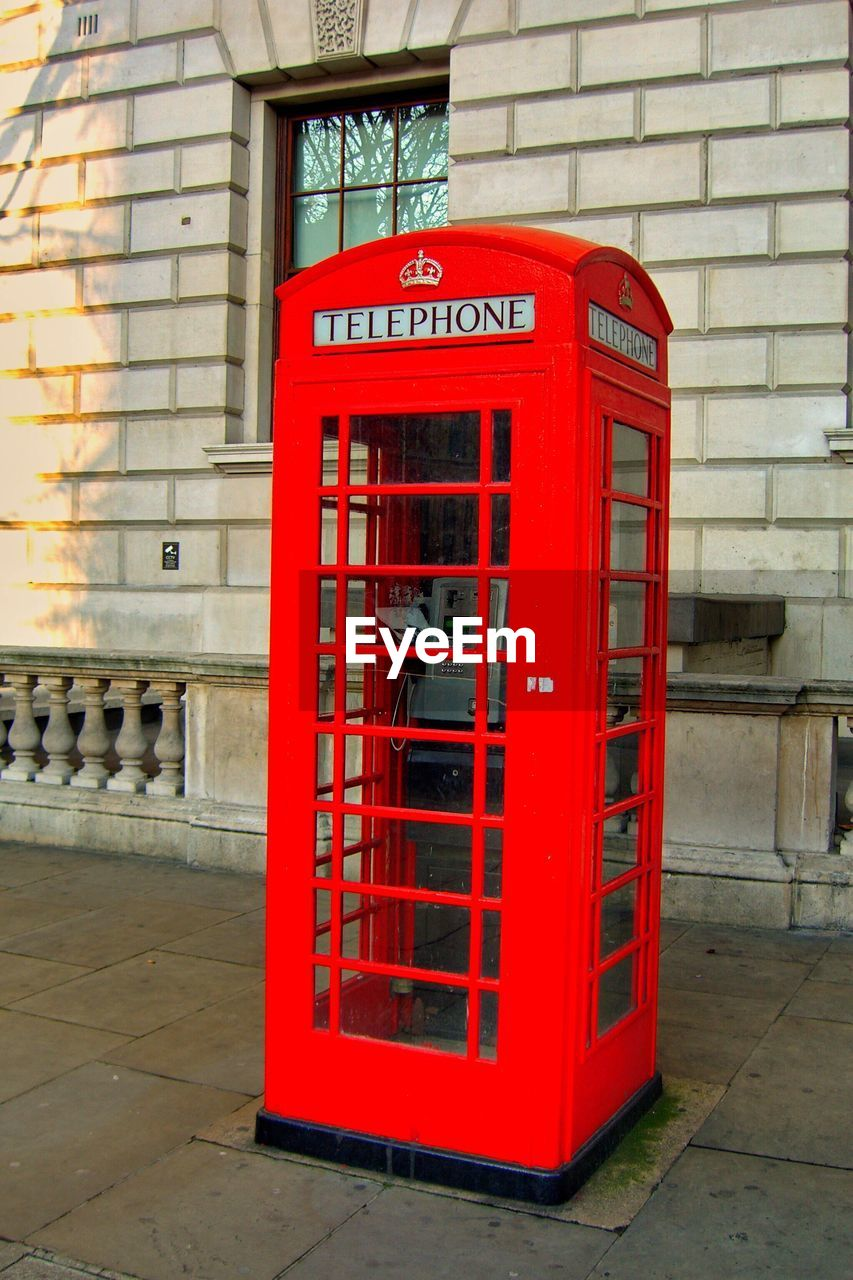 Close-Up Of Telephone Booth On Sidewalk