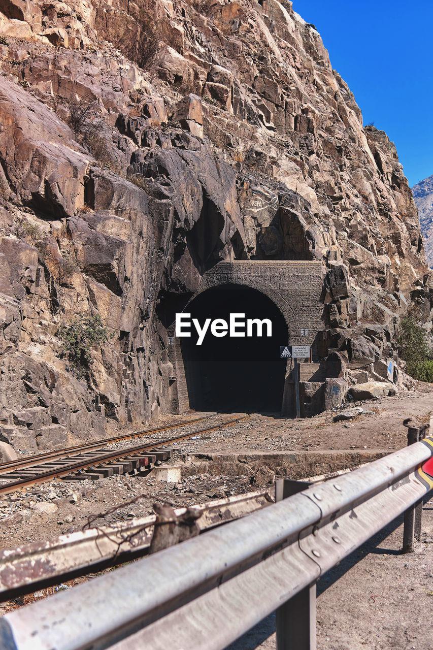 ARCH BRIDGE AGAINST ROCK FORMATION