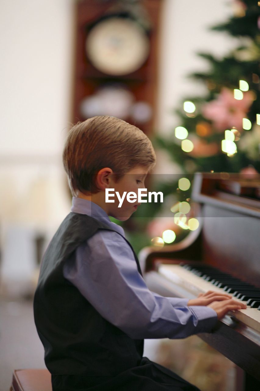 boys, childhood, piano, musical instrument, music, playing, real people, one person, focus on foreground, indoors, learning, illuminated, one boy only, day