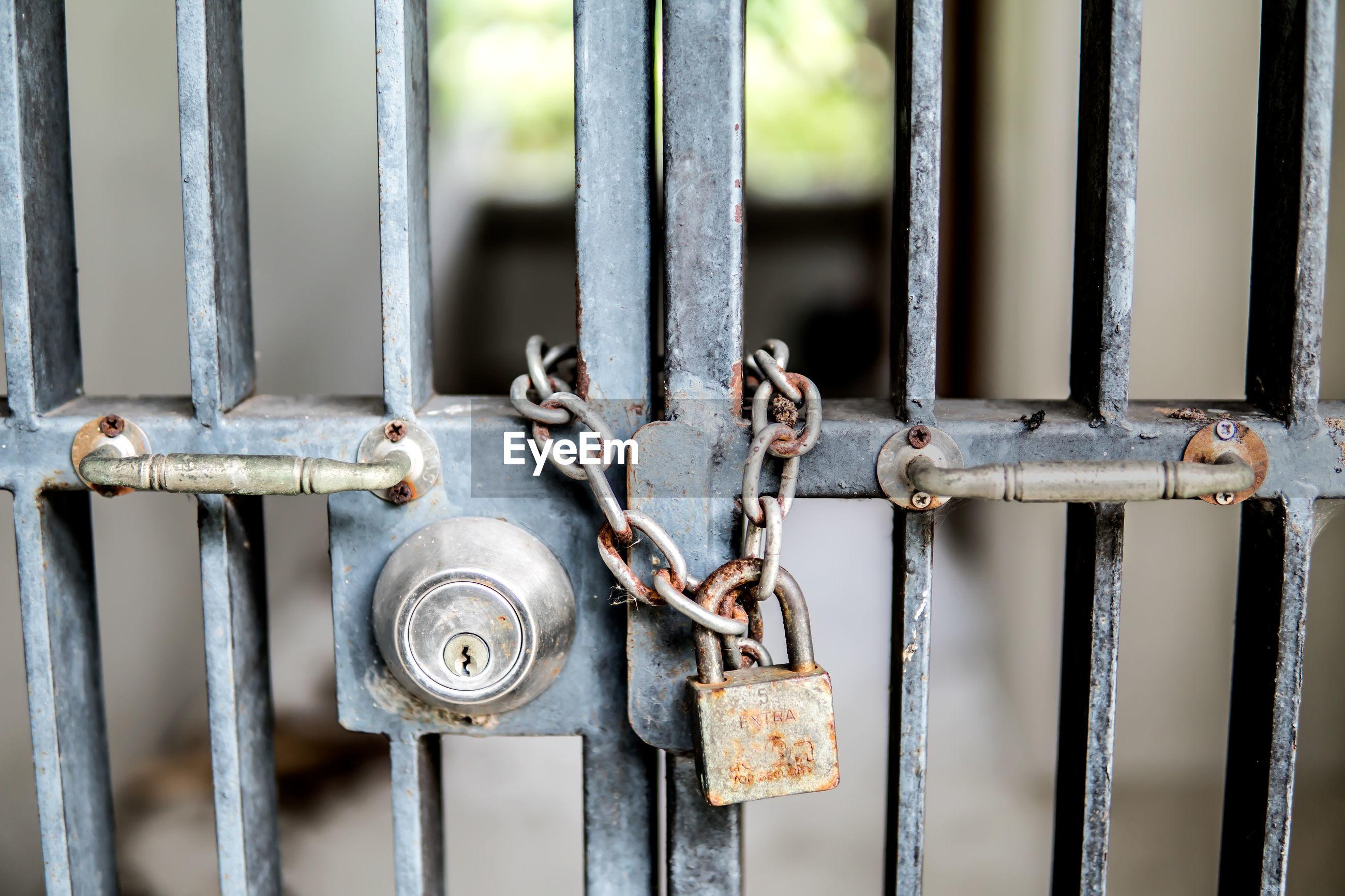 Close-up of locked metal gate