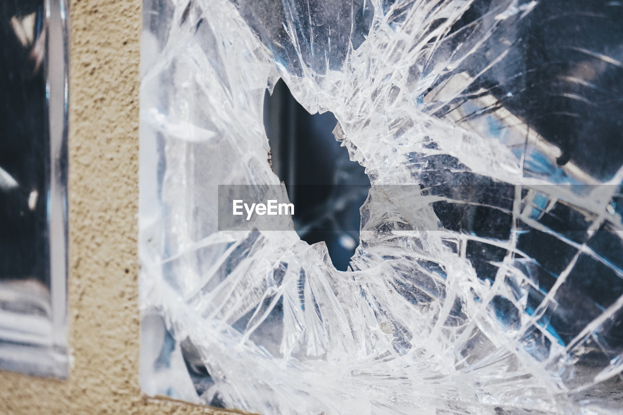 FULL FRAME SHOT OF BROKEN GLASS WINDOW