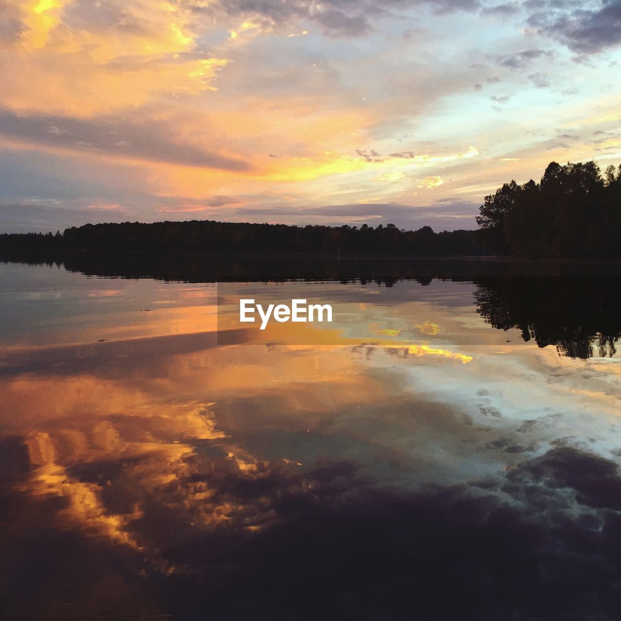 sunset, reflection, sky, water, cloud - sky, tranquil scene, nature, tranquility, scenics, beauty in nature, silhouette, idyllic, outdoors, no people, lake, tree, day