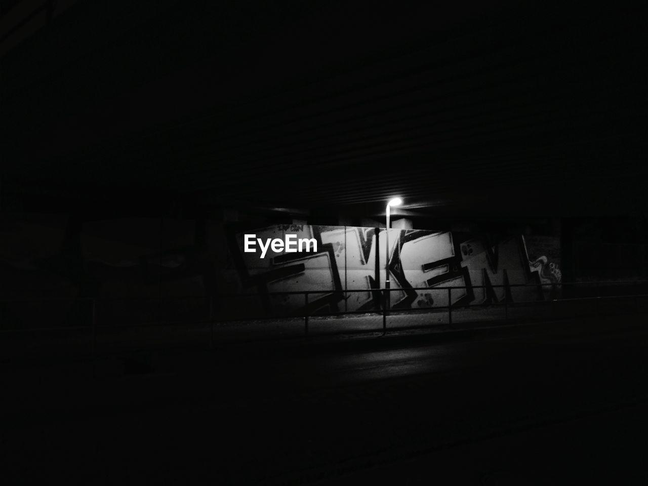night, illuminated, dark, real people, indoors, men, one person, people