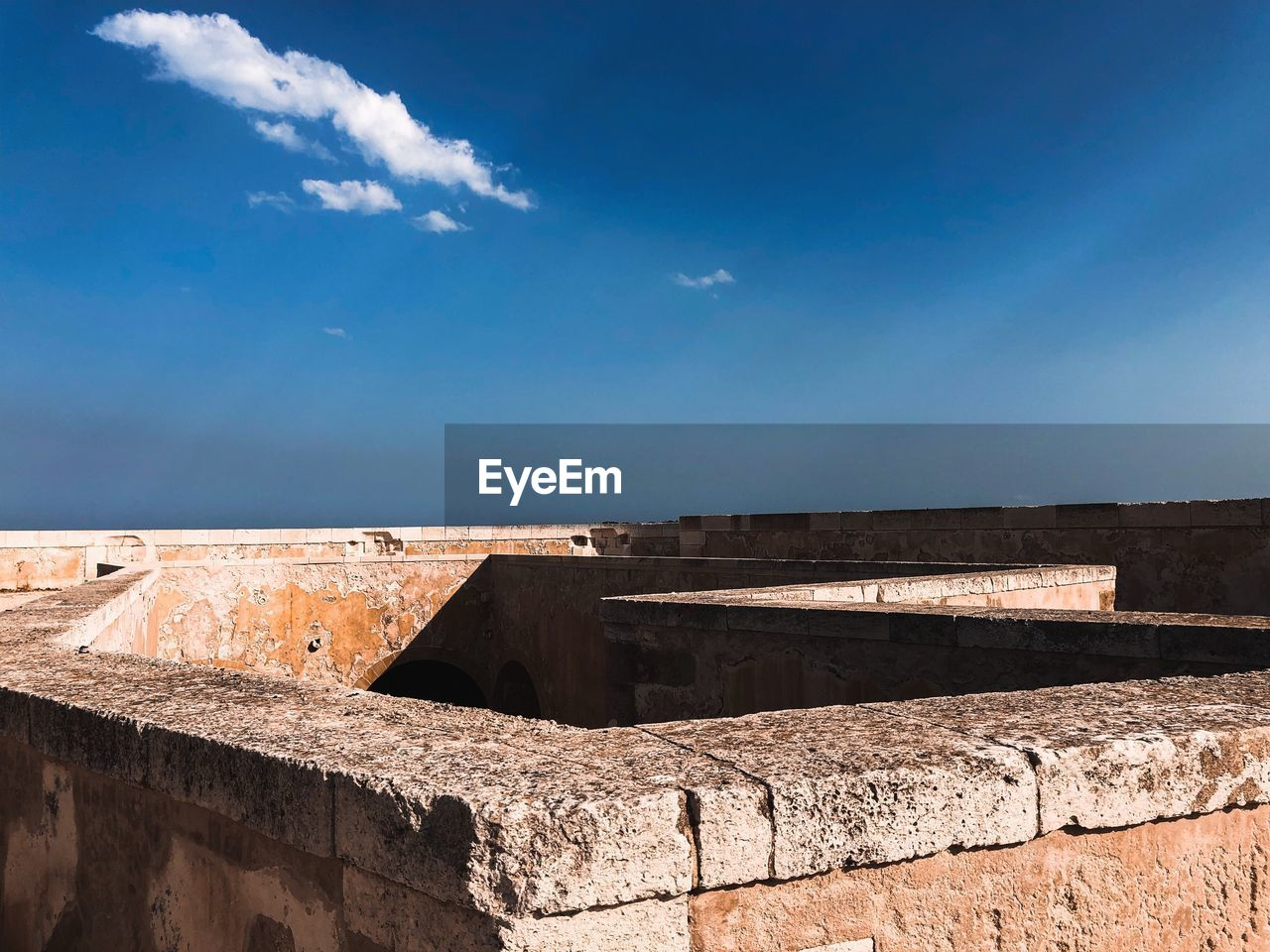sky, architecture, built structure, the past, building exterior, history, cloud - sky, nature, sunlight, fort, blue, wall, day, fortified wall, old, travel destinations, wall - building feature, no people, retaining wall, ancient, outdoors, stone wall, ancient civilization, ruined