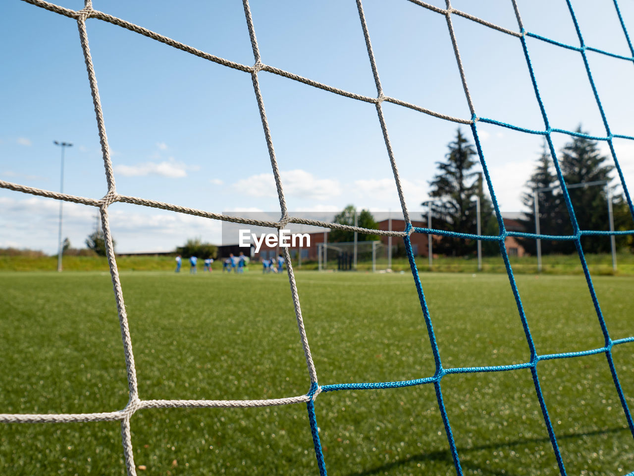 Soccer field in the bright light of summer day. prepared playground for finnal match