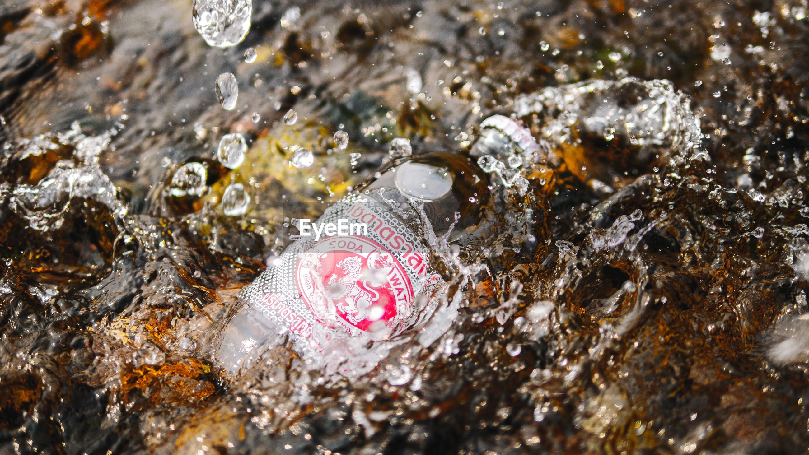 HIGH ANGLE VIEW OF RAINDROPS ON PINK WATER