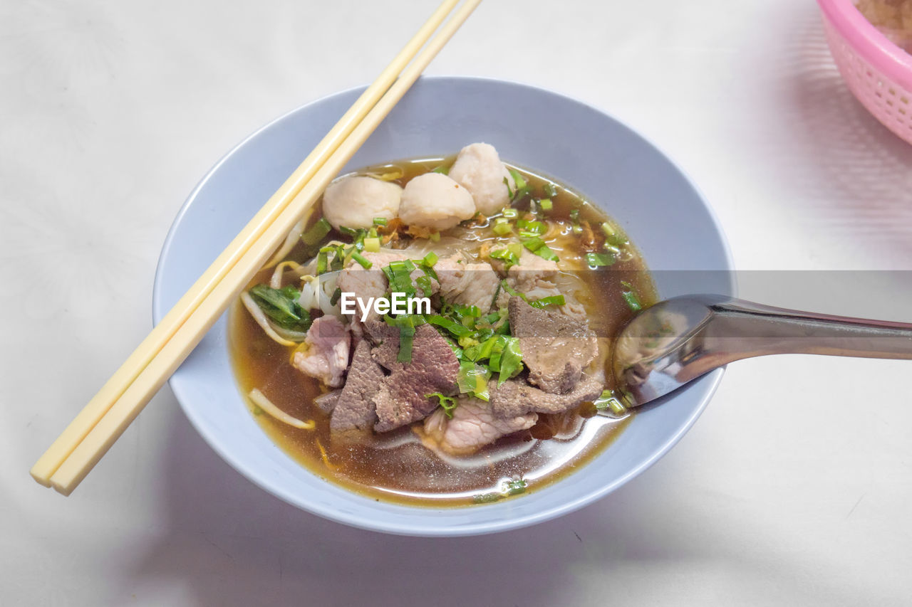 food, eating utensil, bowl, spoon, kitchen utensil, ready-to-eat, food and drink, freshness, healthy eating, soup, table, chopsticks, wellbeing, meat, high angle view, indoors, pasta, asian food, no people, meal, beef, soup bowl, chinese food, noodle soup, crockery