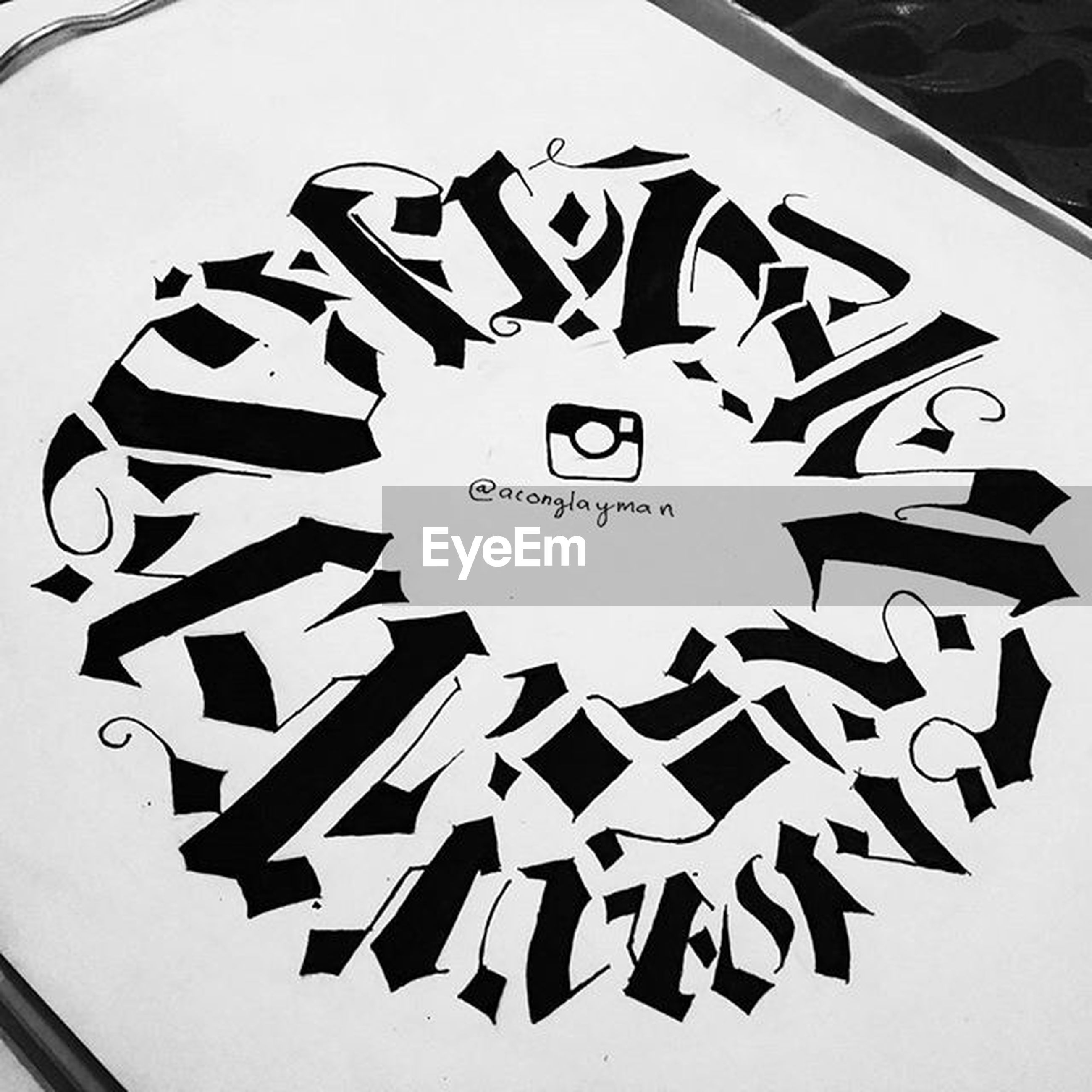 text, western script, communication, low angle view, art and craft, art, indoors, creativity, design, close-up, pattern, capital letter, circle, geometric shape, shape, no people, built structure, architecture, white color, number