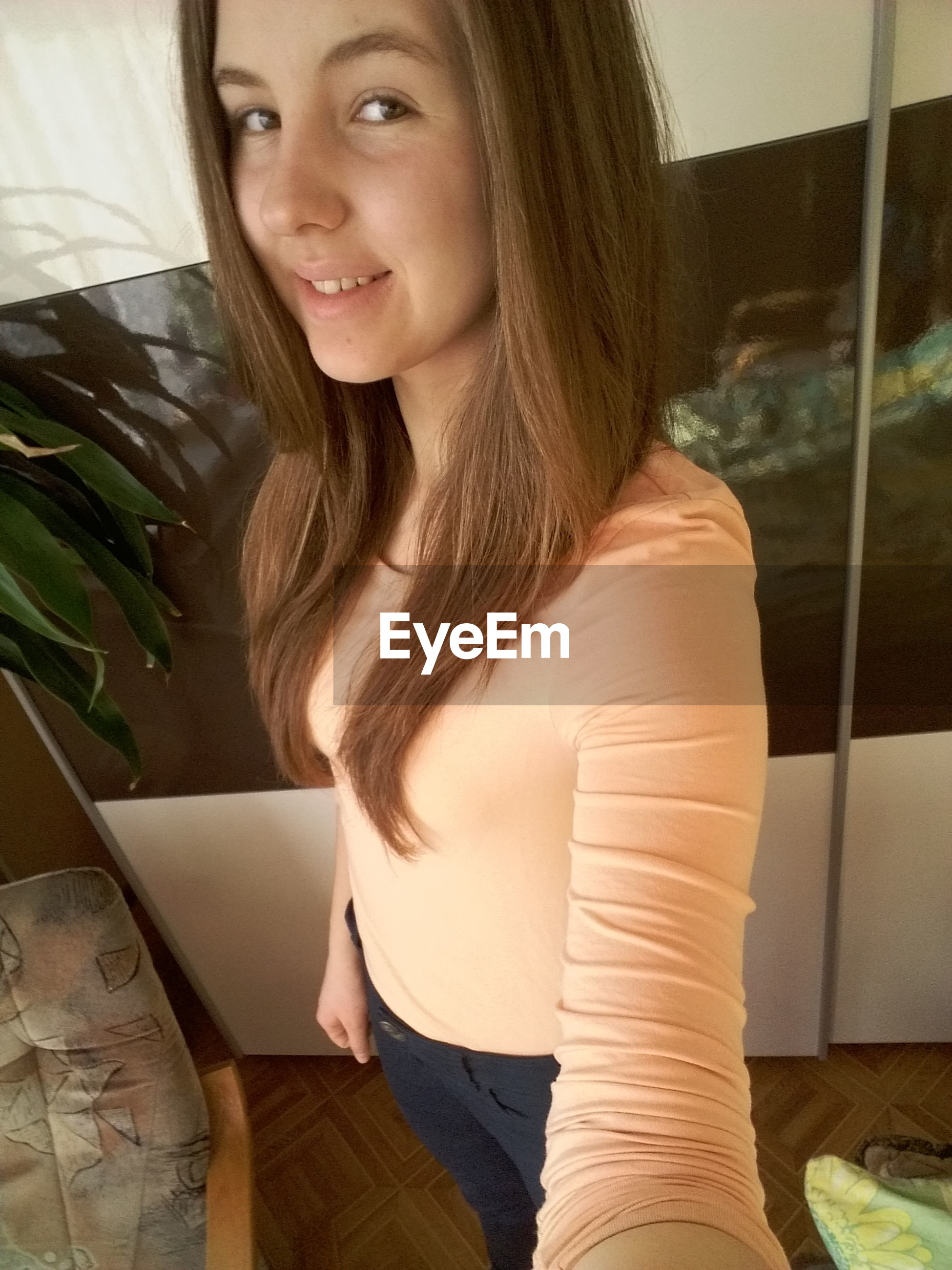 person, young adult, lifestyles, casual clothing, indoors, young women, leisure activity, headshot, sitting, waist up, portrait, relaxation, front view, long hair, mid adult, looking at camera, head and shoulders, side view