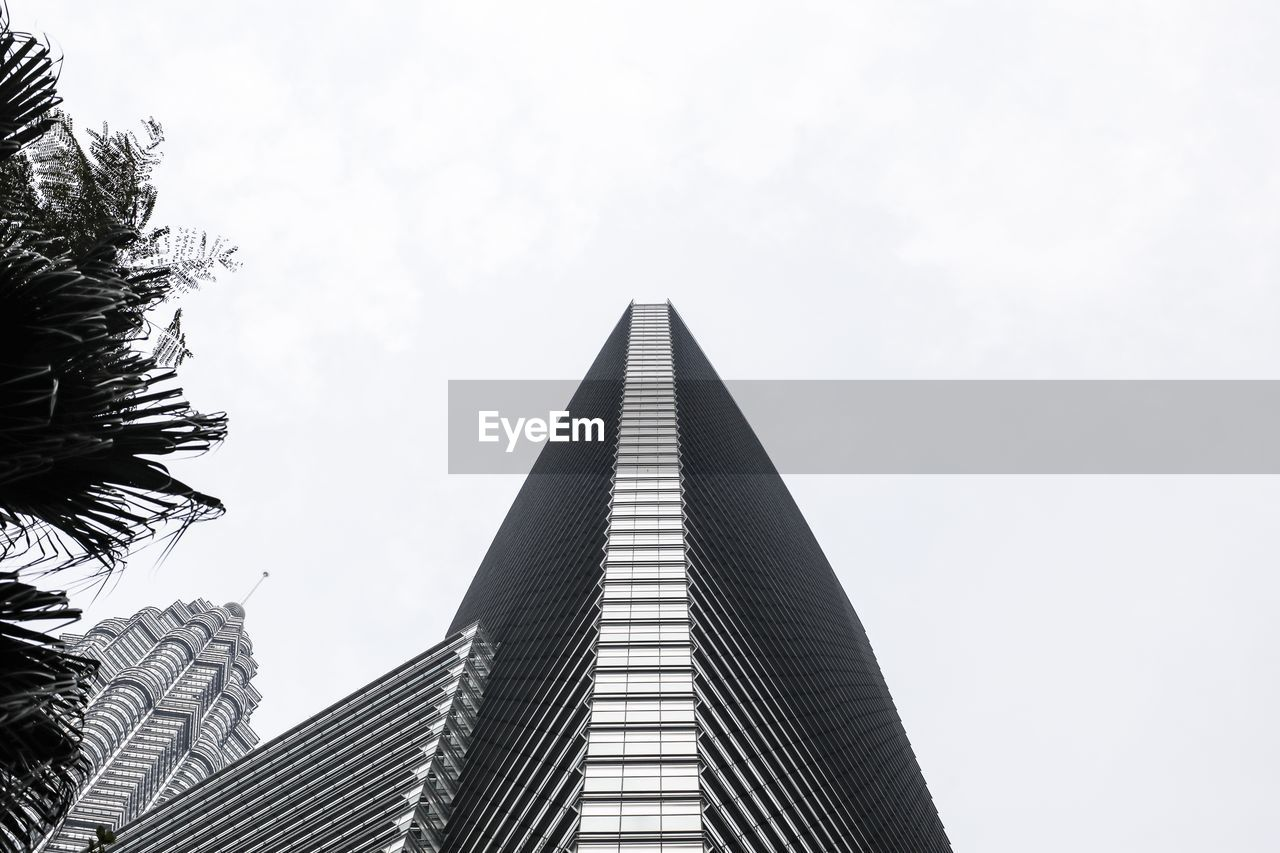 sky, built structure, low angle view, architecture, building exterior, nature, building, day, no people, office building exterior, tall - high, modern, tree, office, city, plant, clear sky, skyscraper, outdoors, pattern