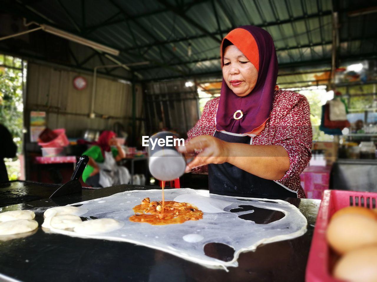 Mature woman preparing food