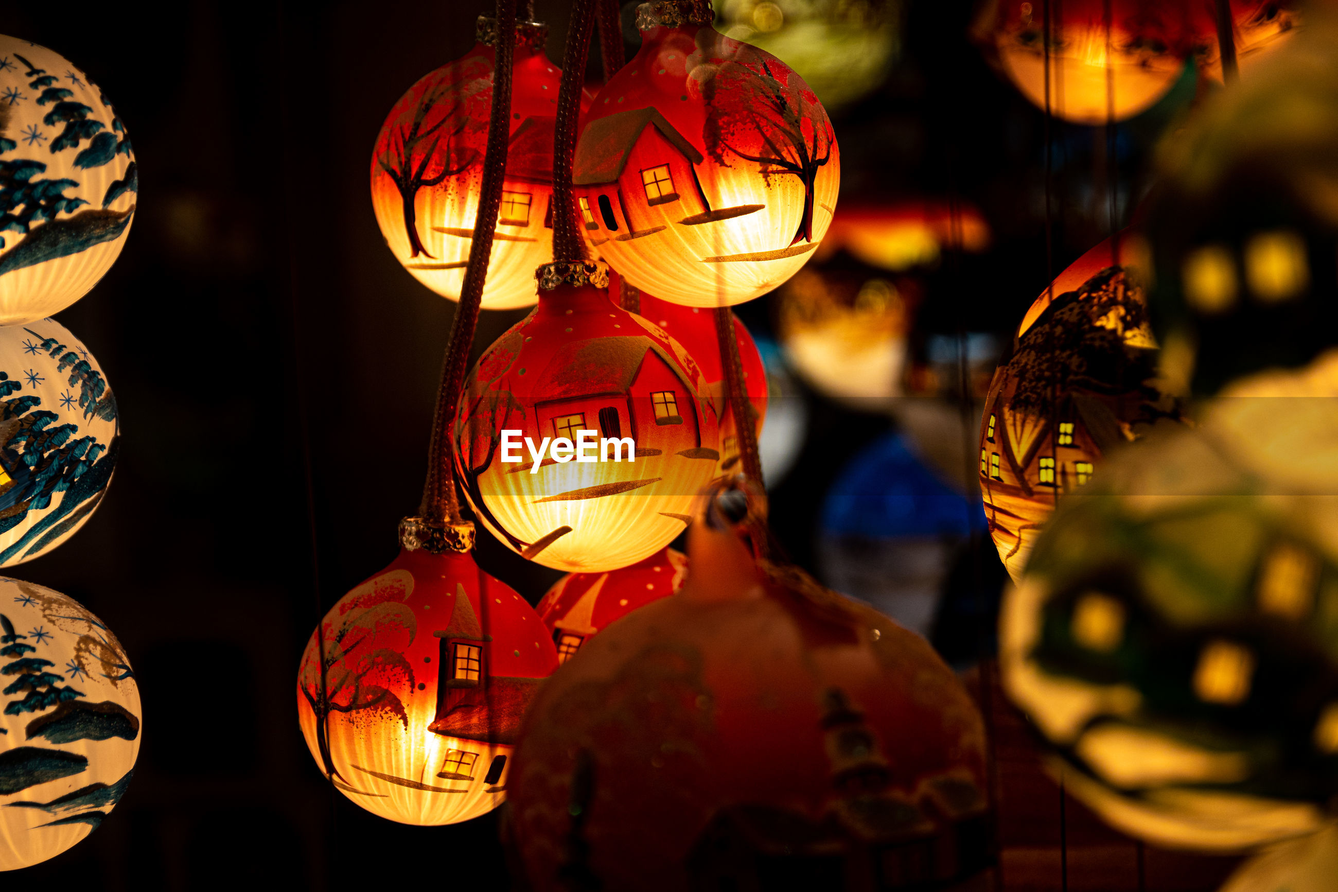 Illuminated lanterns hanging at night