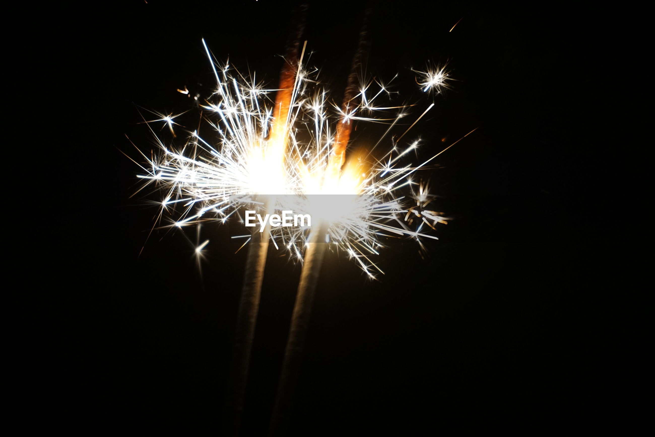 firework - man made object, firework display, night, sparks, exploding, long exposure, arts culture and entertainment, celebration, illuminated, sparkler, glowing, no people, motion, event, low angle view, blurred motion, firework, outdoors, black background, close-up, sky