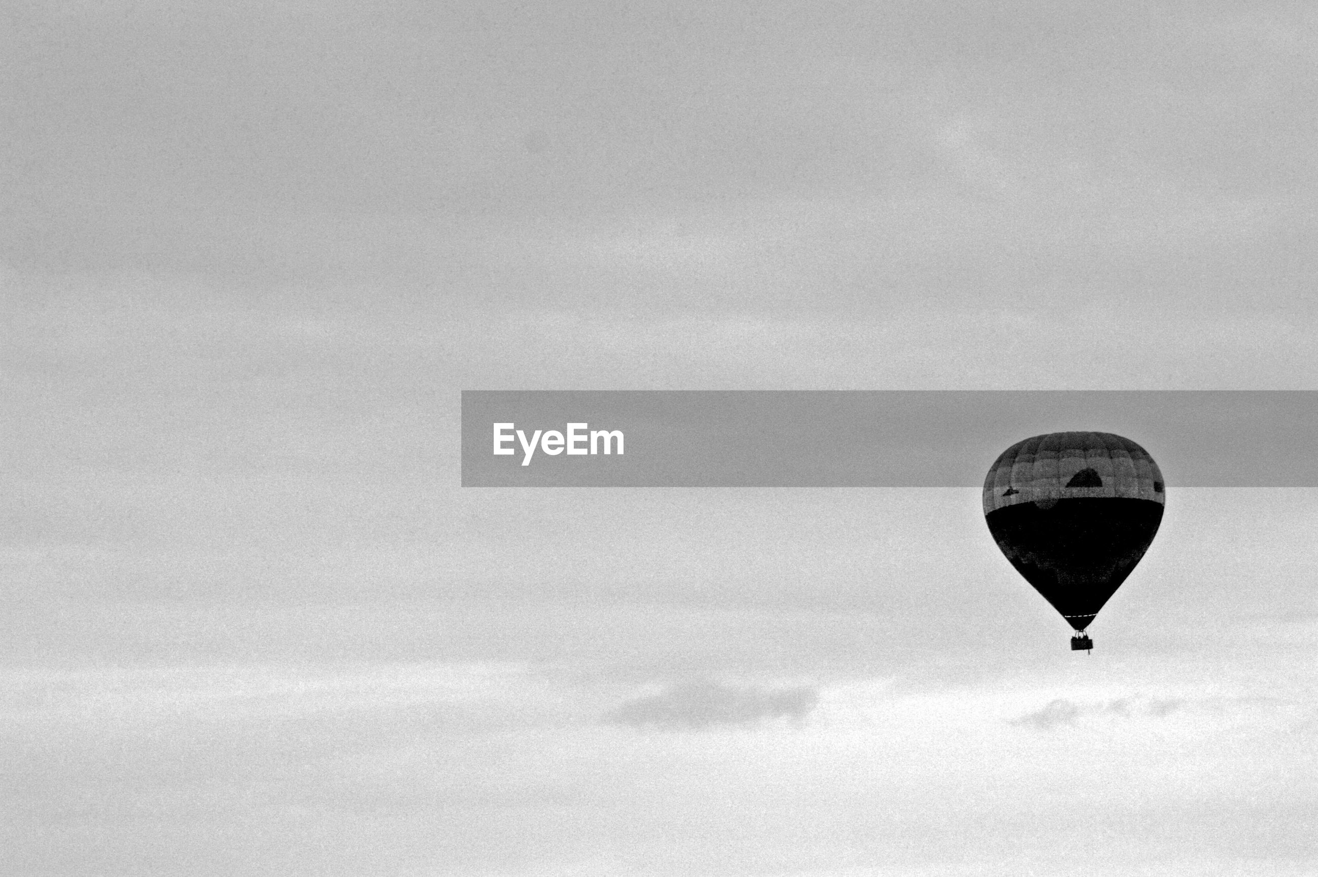 Scenic view of hot air balloon flying against sky