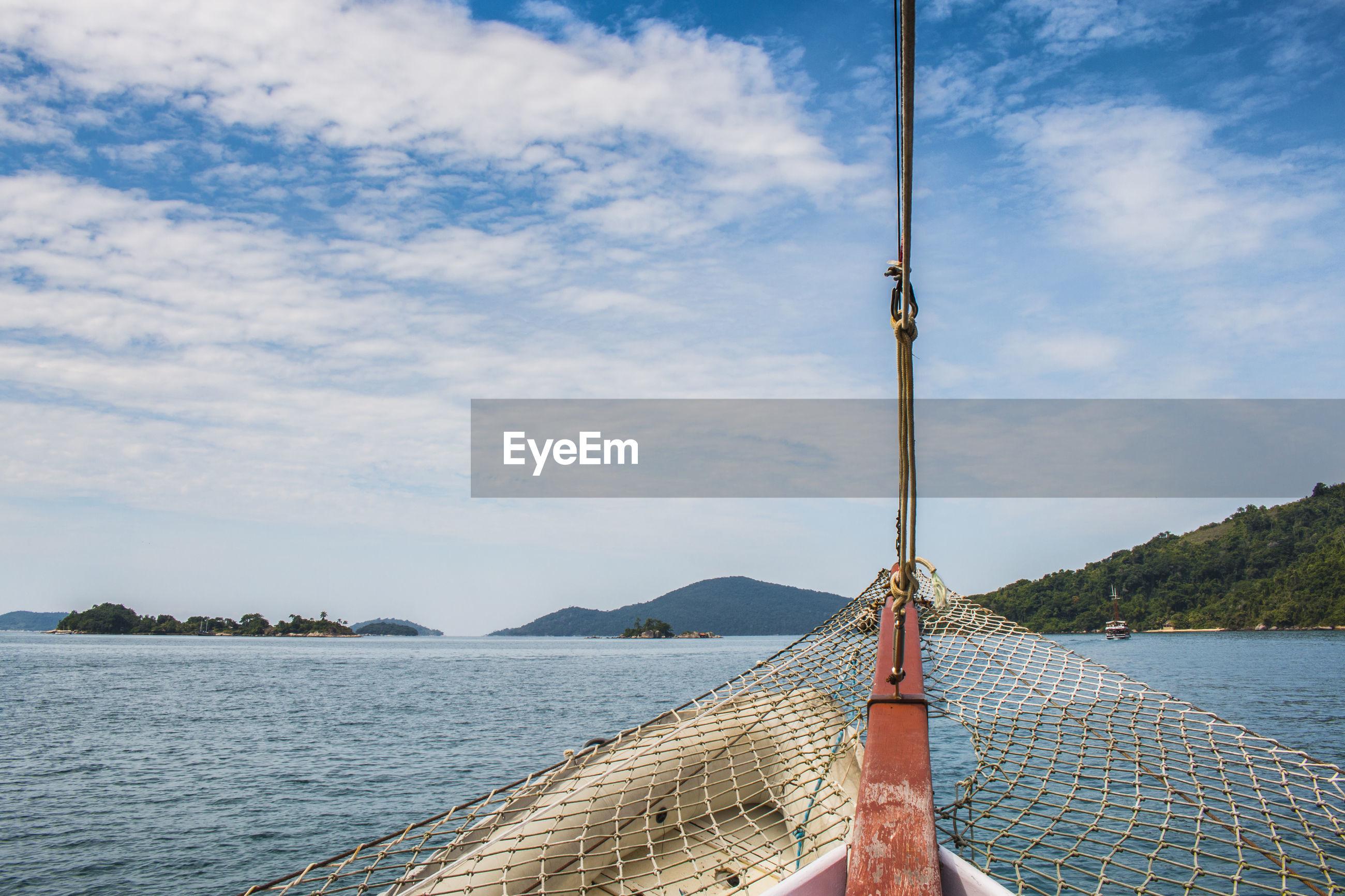 Fishing net on boat in sea against sky