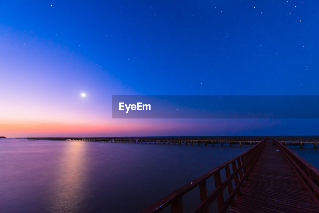 Scenic View Of Sea Against Sky At Dusk