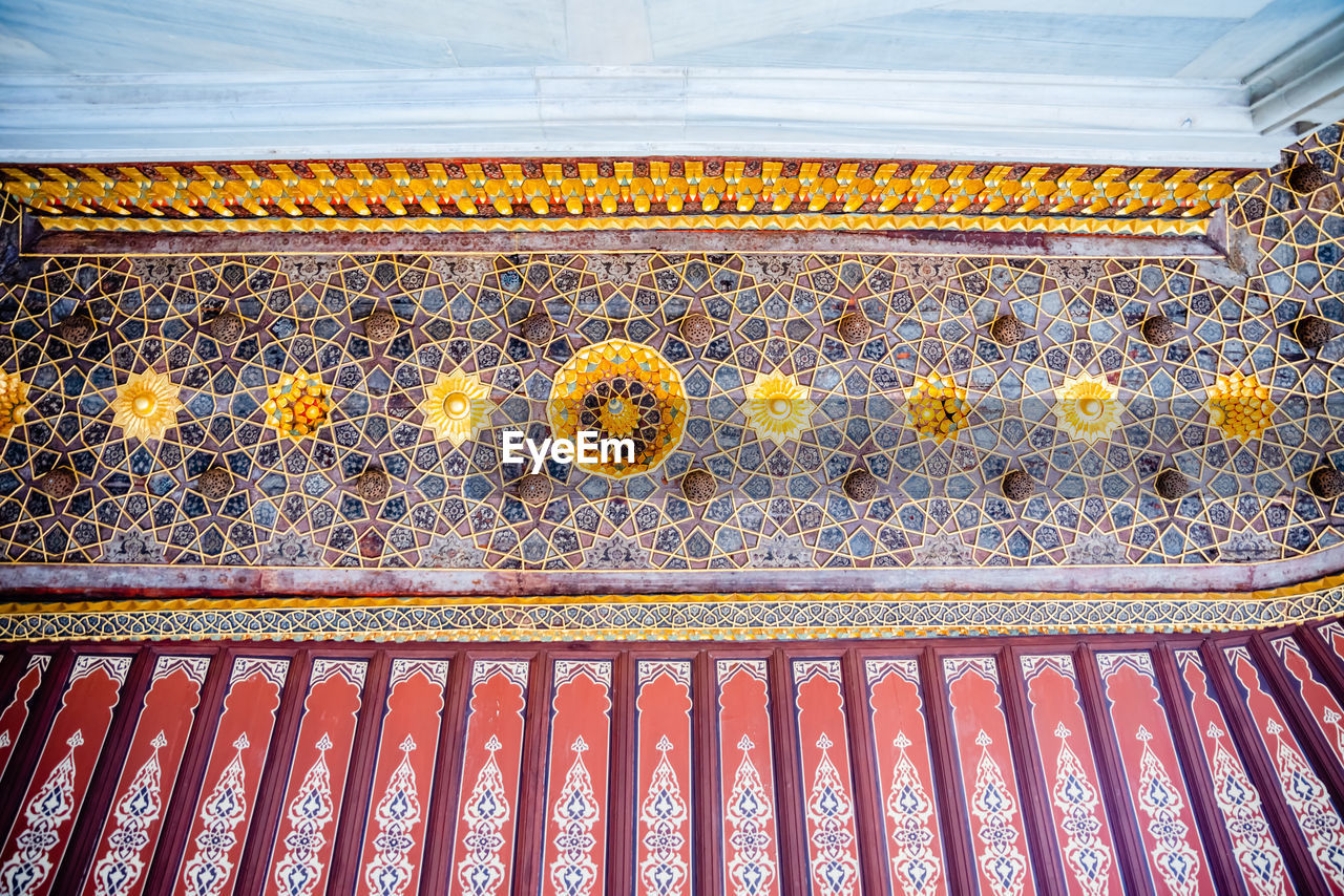 pattern, no people, low angle view, design, architecture, built structure, indoors, day, floral pattern, religion, creativity, metal, ornate, building, red, full frame, close-up, belief, art and craft, place of worship, ceiling