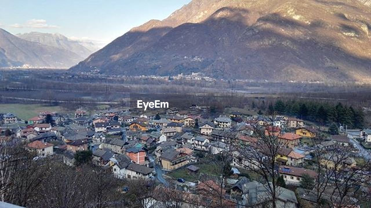 mountain, landscape, outdoors, mountain range, day, no people, town, scenics, nature, cityscape, sky