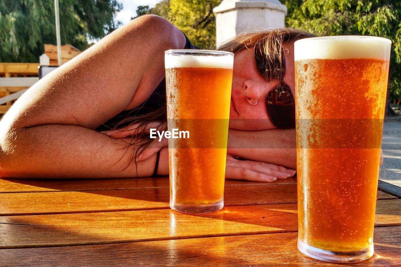 drink, beer, refreshment, alcohol, beer - alcohol, food and drink, beer glass, table, drinking glass, glass, adult, lifestyles, real people, leisure activity, freshness, one person, relaxation, women, close-up, household equipment, pint glass, frothy drink
