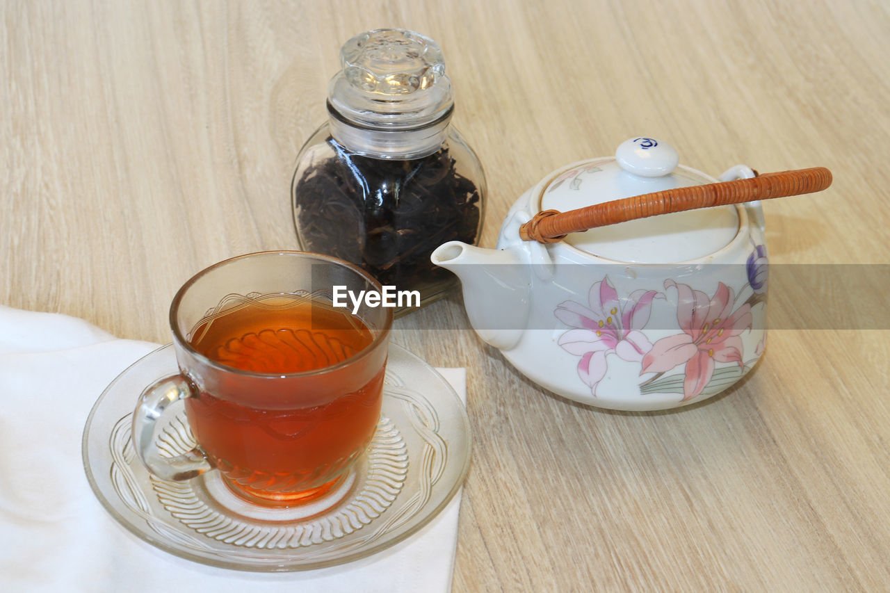 food and drink, table, refreshment, indoors, drink, food, cup, container, jar, saucer, high angle view, mug, no people, tea - hot drink, still life, close-up, glass - material, spoon, freshness, wood - material, hot drink, crockery, teapot, tea cup, glass