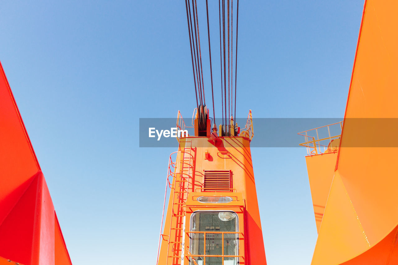 day, low angle view, built structure, construction site, crane - construction machinery, outdoors, architecture, blue, clear sky, no people, sky
