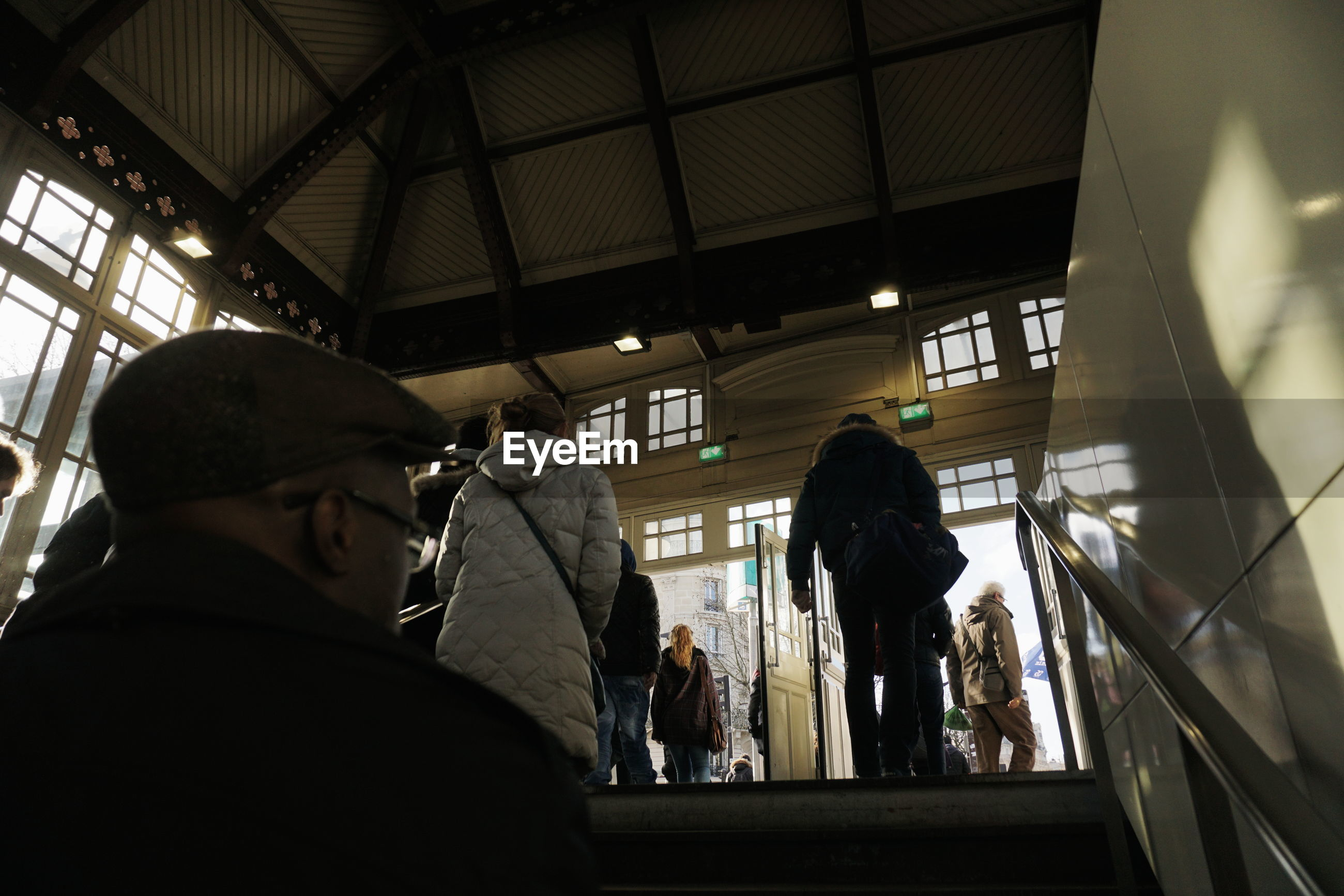 indoors, lifestyles, men, leisure activity, person, rear view, casual clothing, standing, photographing, built structure, architecture, togetherness, technology, photography themes, full length, three quarter length, travel