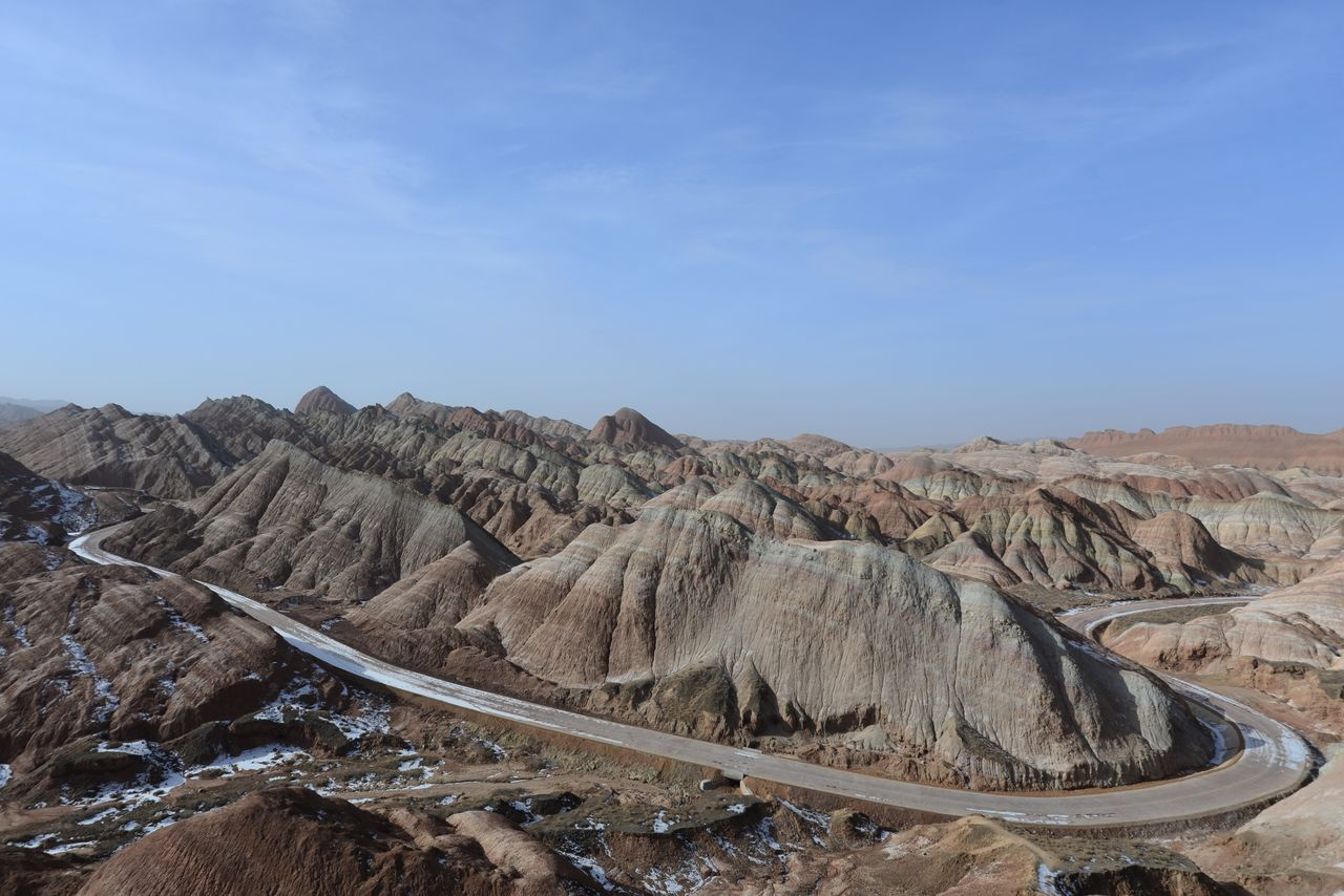 sky, scenics - nature, tranquility, landscape, tranquil scene, environment, non-urban scene, beauty in nature, mountain, rock, day, nature, rock formation, solid, land, remote, rock - object, geology, no people, physical geography, mountain range, outdoors, arid climate, climate, formation, eroded