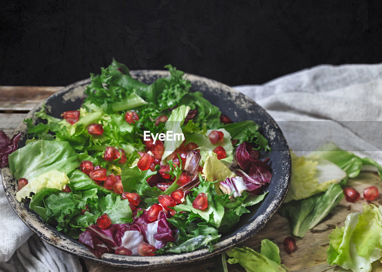 High angle view of salad in plate on table against black background