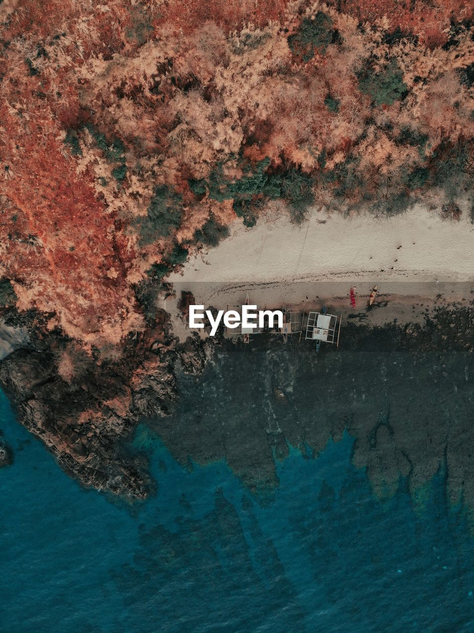 Aerial view of sea by landscape