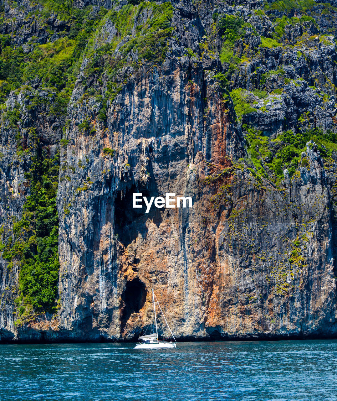 water, sea, rock, rock - object, solid, cliff, rock formation, nature, land, day, scenics - nature, outdoors, beauty in nature, no people, nautical vessel, tranquility, waterfront, tranquil scene, beach, formation