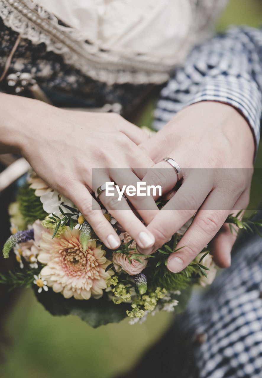 human hand, hand, flower, flowering plant, women, ring, adult, togetherness, real people, midsection, plant, couple - relationship, two people, human body part, jewelry, bouquet, wedding, bonding, flower arrangement, heterosexual couple, positive emotion, body part, finger