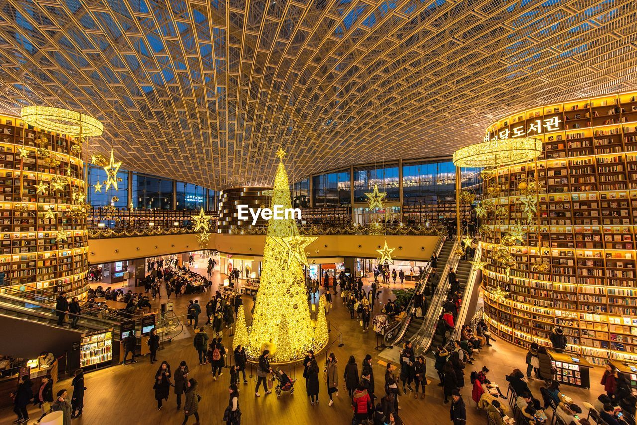 group of people, crowd, large group of people, real people, architecture, illuminated, built structure, city, building exterior, men, lifestyles, women, night, adult, city life, leisure activity, shopping, tourism, travel, outdoors, light, consumerism