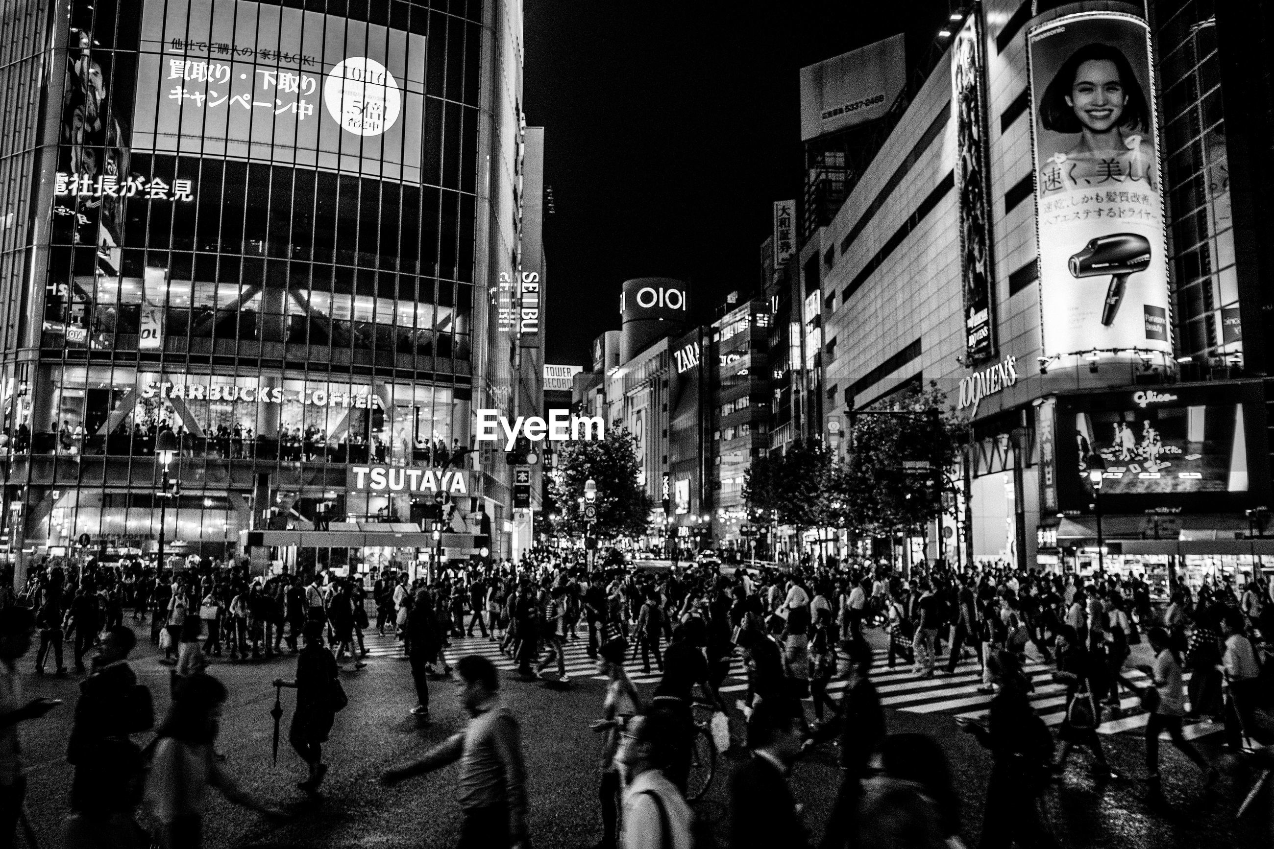 People at shibuya crossroad in city