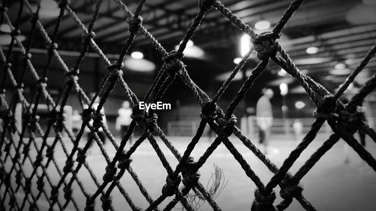 fence, focus on foreground, protection, metal, security, barrier, no people, safety, boundary, close-up, chainlink fence, day, nature, outdoors, full frame, pattern, selective focus, backgrounds, sky, barbed wire