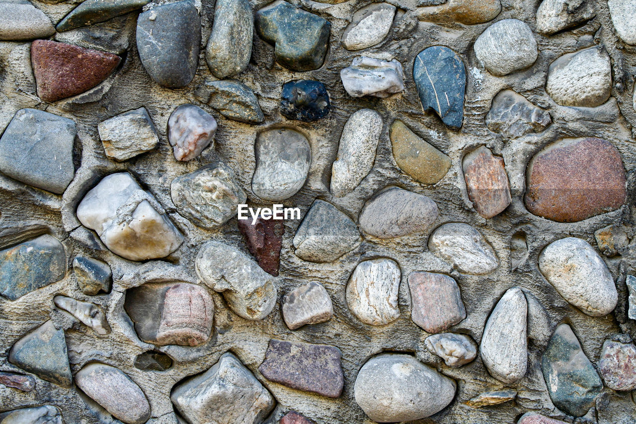 full frame, backgrounds, solid, no people, rock, day, rock - object, nature, textured, stone - object, close-up, large group of objects, outdoors, rough, stone, high angle view, architecture, stone wall, wall, abundance, pebble