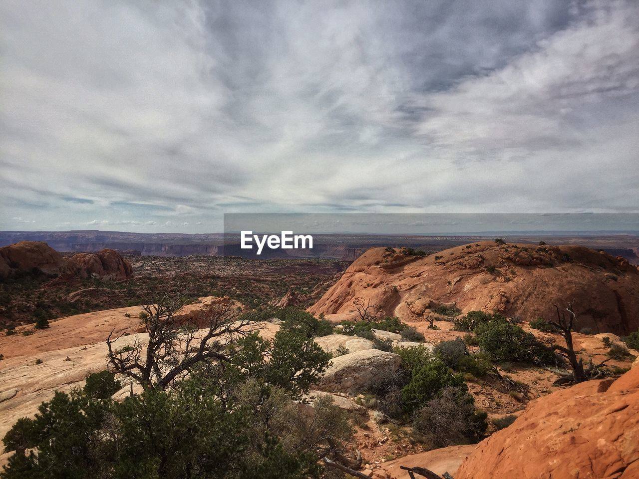tranquil scene, scenics, tranquility, nature, beauty in nature, landscape, geology, non-urban scene, sky, day, outdoors, no people, rock - object, mountain, cloud - sky, travel destinations, physical geography, arid climate, desert, mountain range, tree