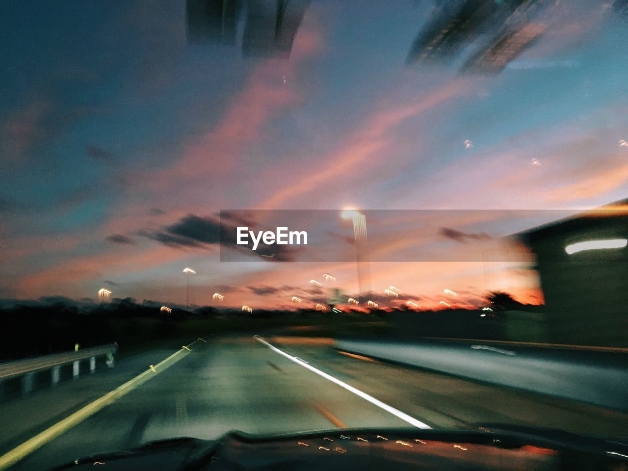 road, car, transportation, windshield, car interior, land vehicle, car point of view, the way forward, sky, cloud - sky, no people, sunset, travel, mode of transport, illuminated, road trip, nature, city, outdoors, day, close-up
