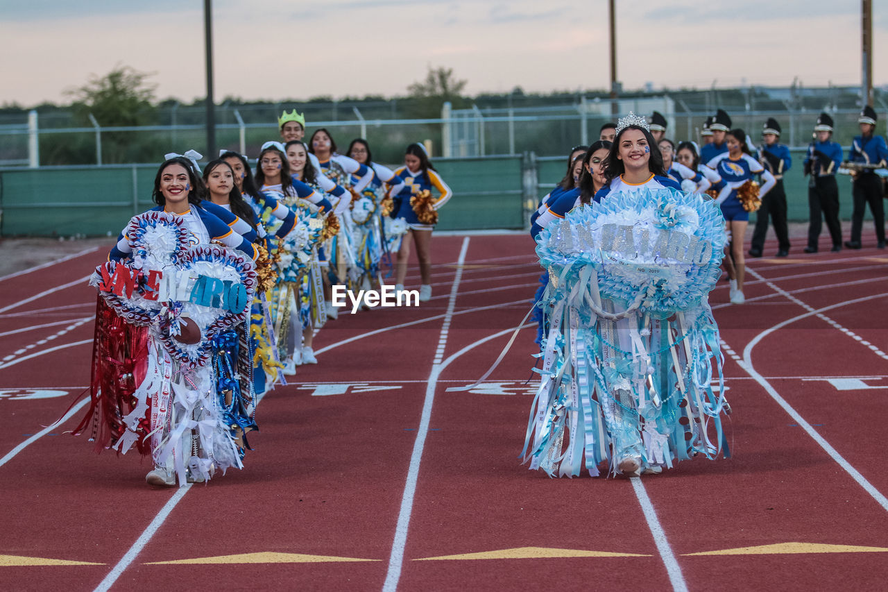 group of people, real people, large group of people, clothing, women, track and field, sport, adult, day, lifestyles, celebration, full length, nature, traditional clothing, outdoors, competition, costume, crowd, performance, festival, spectator