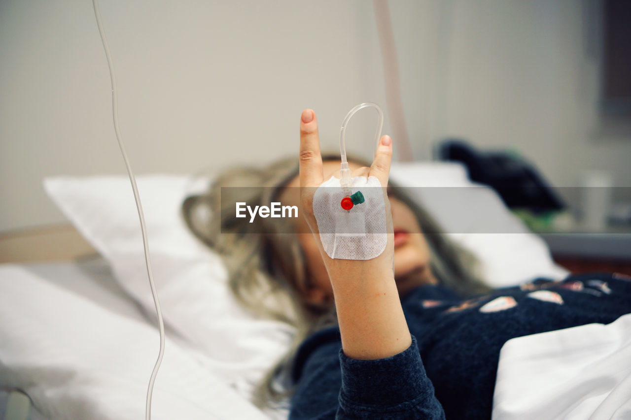 Close-Up Of Hand Of Woman In Hospital