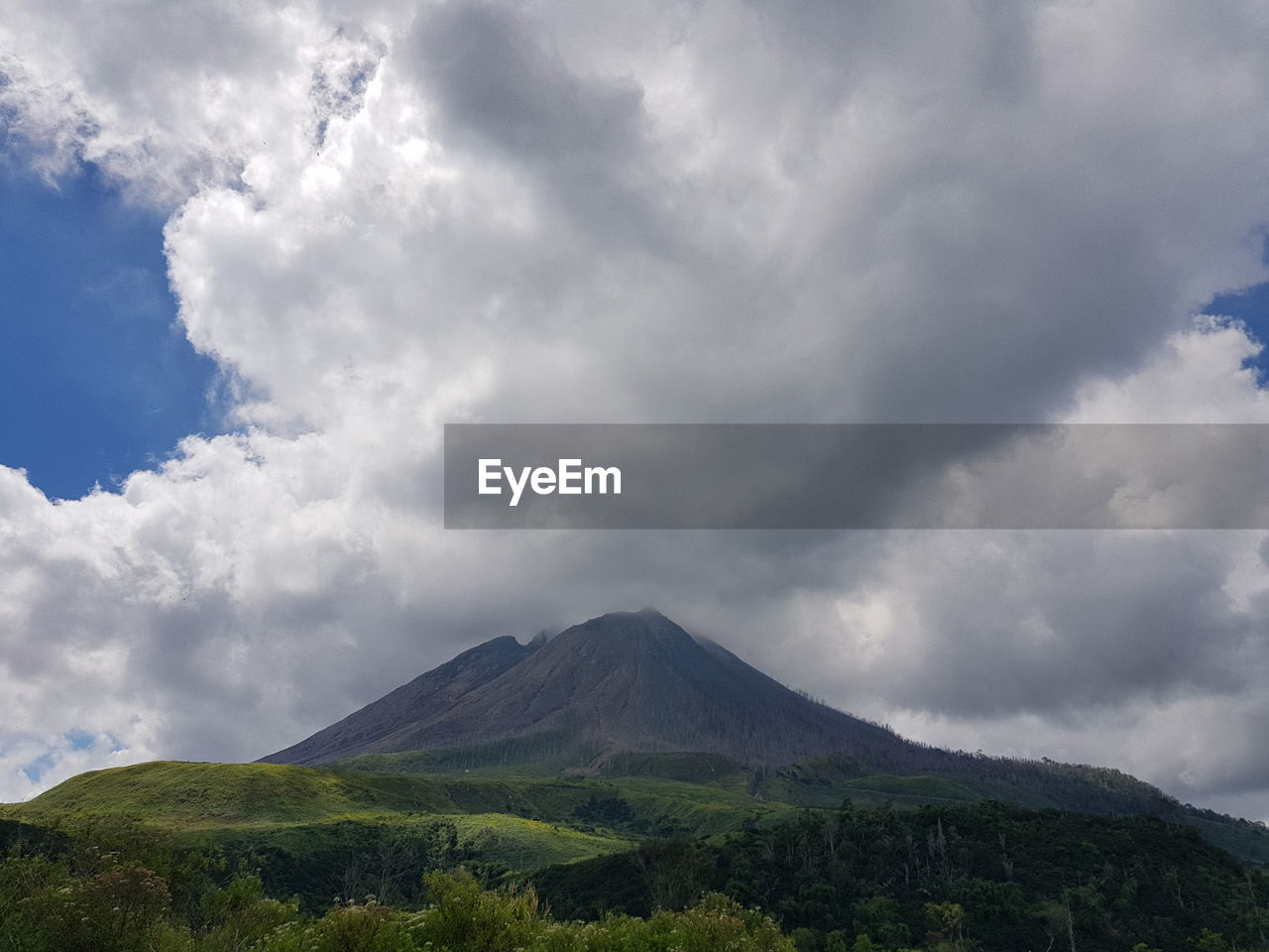 cloud - sky, sky, scenics - nature, volcano, mountain, beauty in nature, tranquil scene, tranquility, landscape, non-urban scene, nature, environment, land, day, no people, geology, outdoors, idyllic, travel destinations, mountain peak, volcanic crater, power in nature, ominous