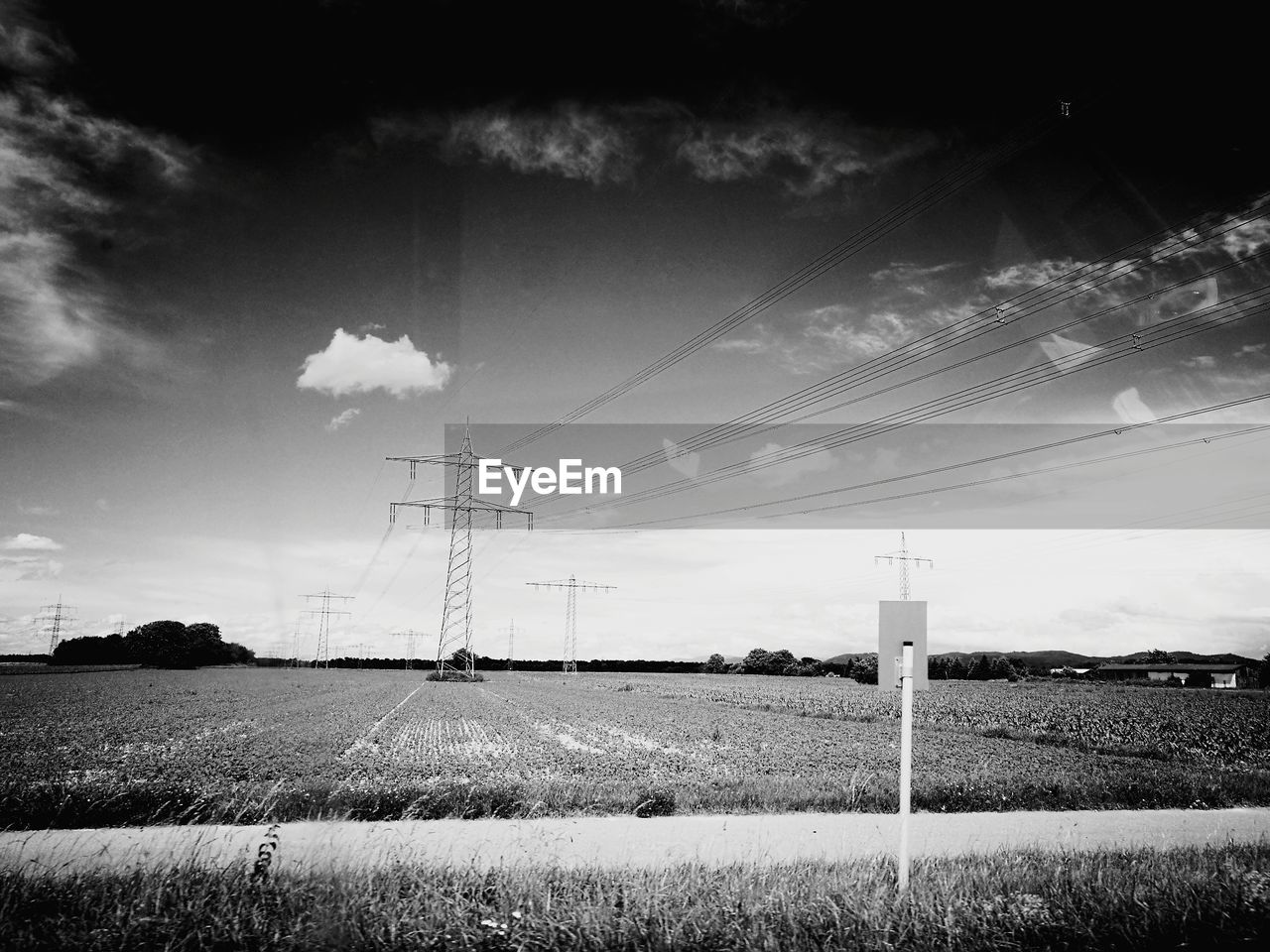 cable, sky, electricity, electricity pylon, power line, power supply, field, connection, no people, cloud - sky, fuel and power generation, nature, technology, day, landscape, rural scene, outdoors, grass, growth, beauty in nature, telephone line