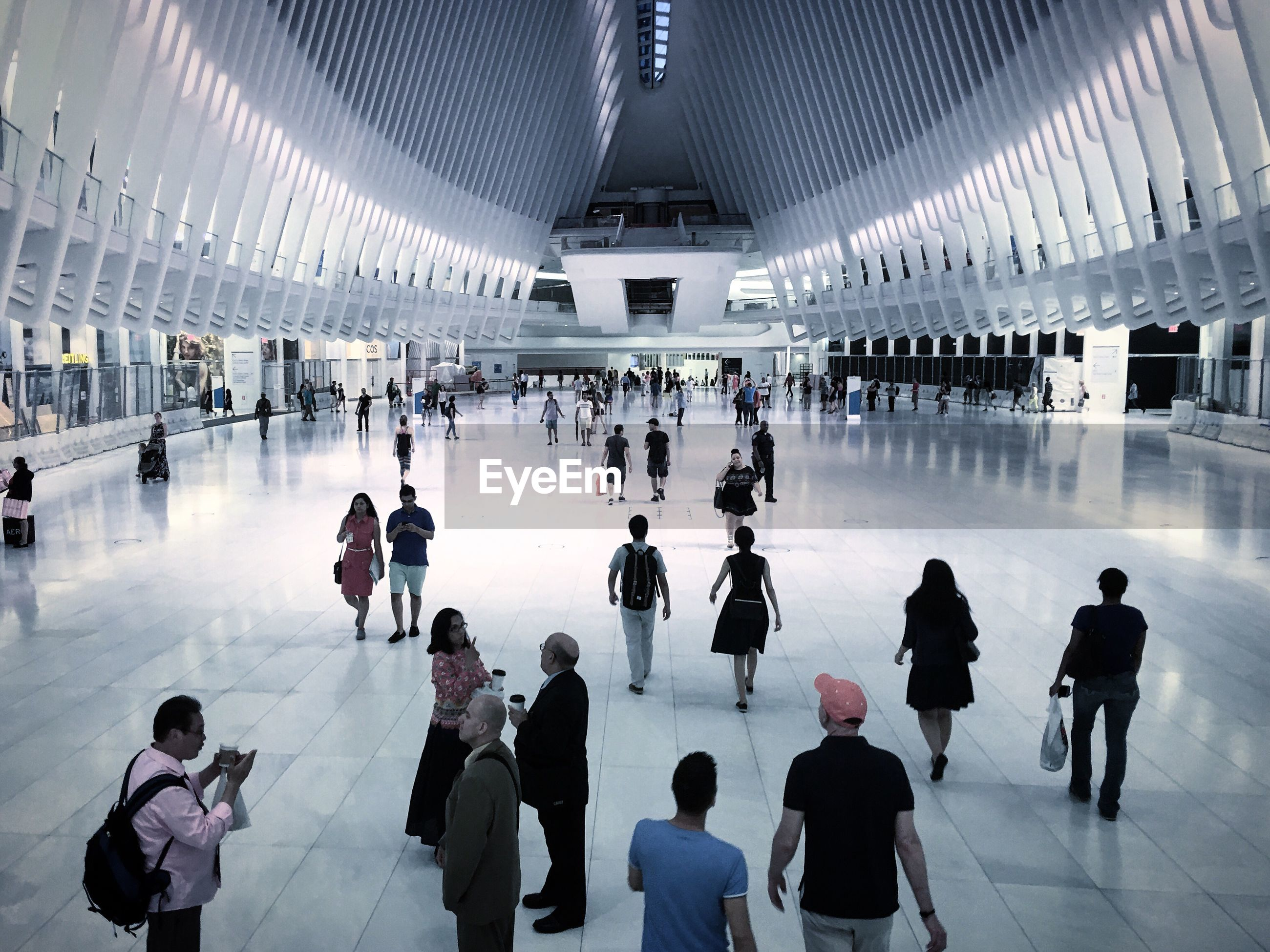 large group of people, men, lifestyles, person, indoors, leisure activity, architecture, travel, city, city life, waiting, casual clothing, travel destinations, crowd, rush hour, shopping, retail, day, subway station, subway platform