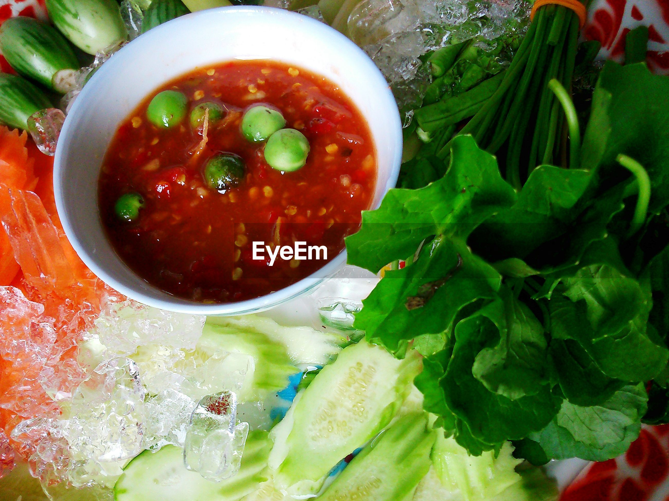 High angle view of fresh vegetables with spicy sauce served in plate