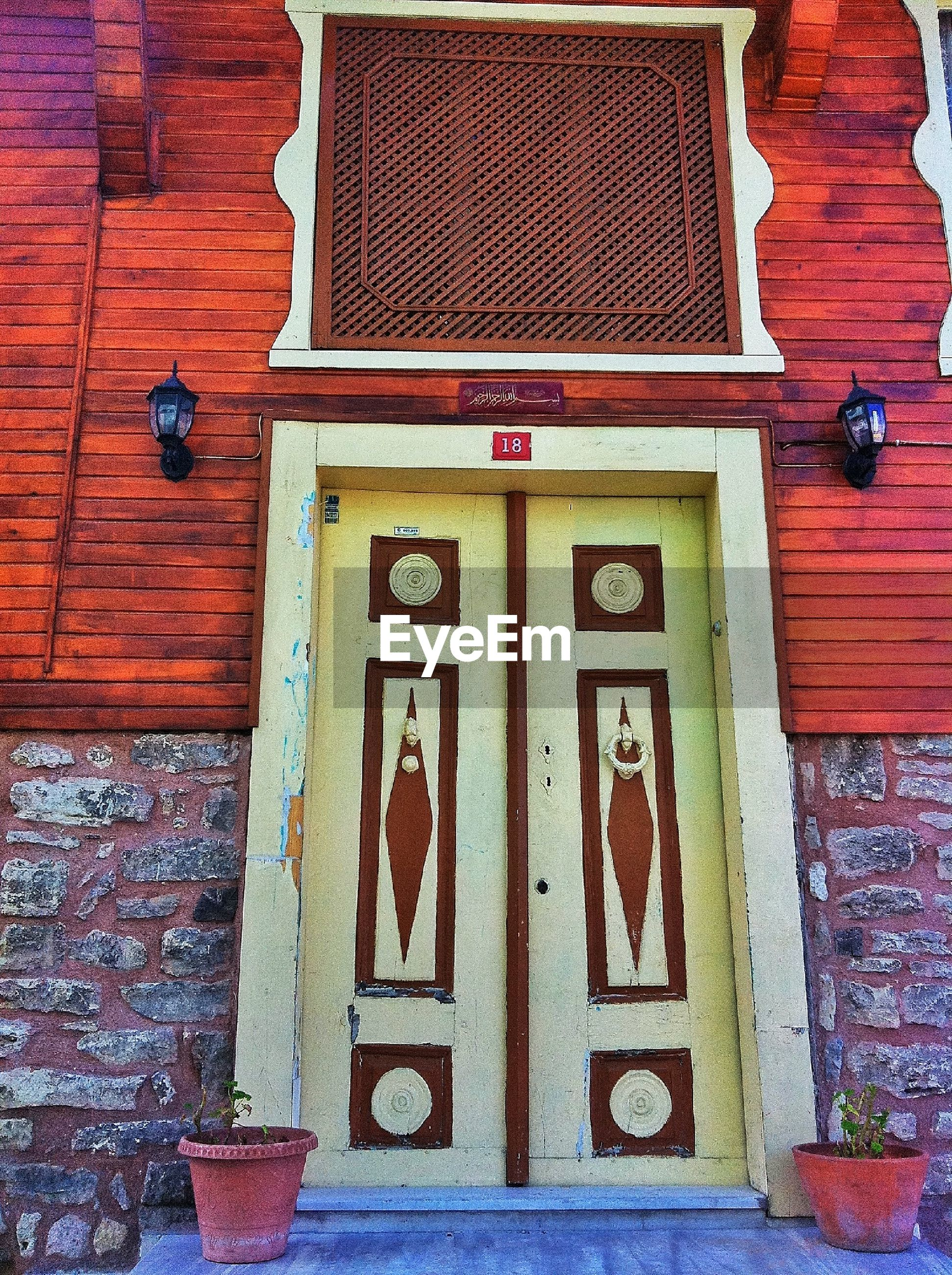 building exterior, architecture, built structure, door, wood - material, text, closed, wall - building feature, communication, wooden, brick wall, red, house, entrance, western script, wall, window, day, shutter, safety
