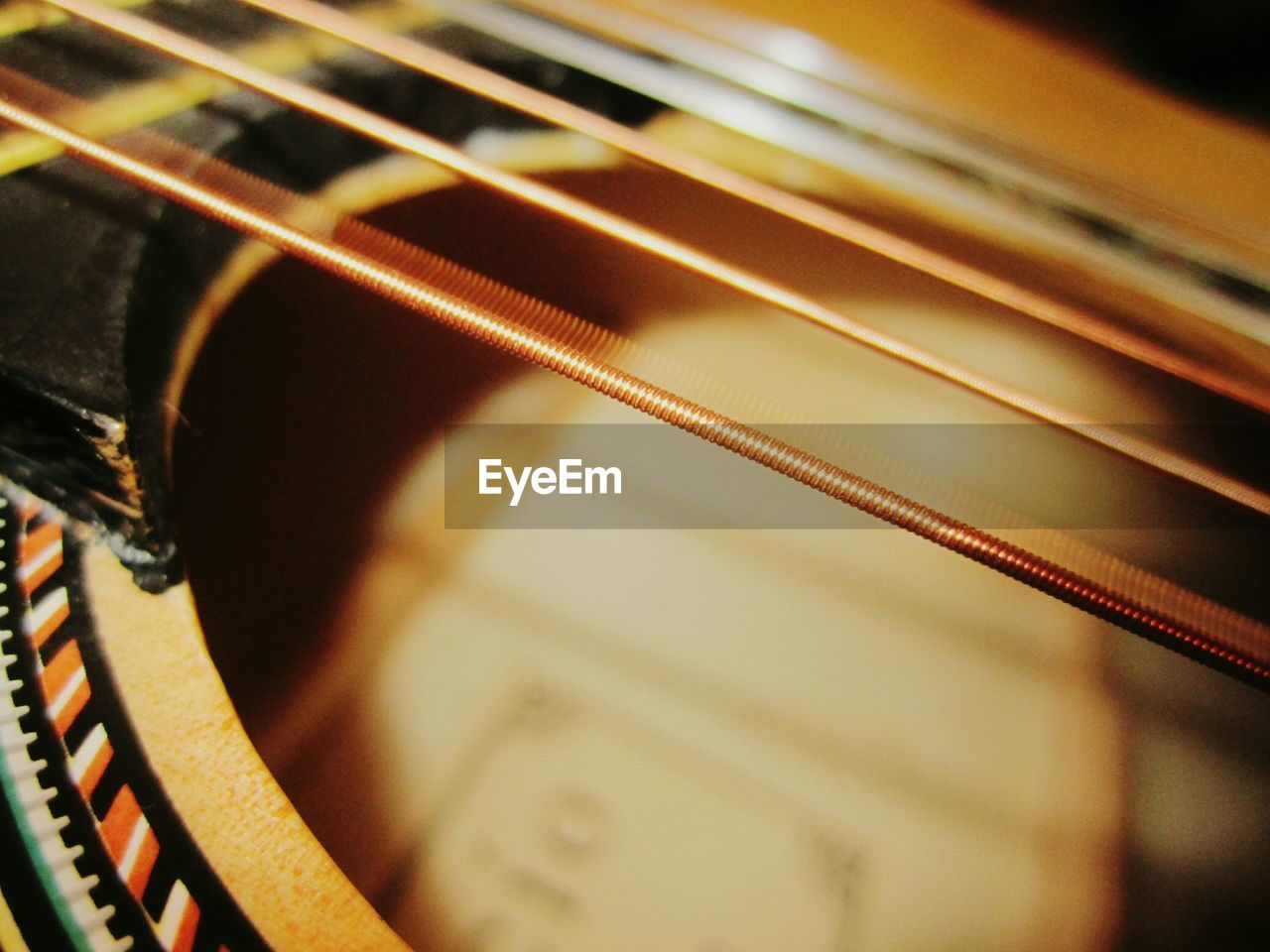 music, musical instrument, musical instrument string, guitar, arts culture and entertainment, indoors, woodwind instrument, fretboard, no people, string instrument, close-up