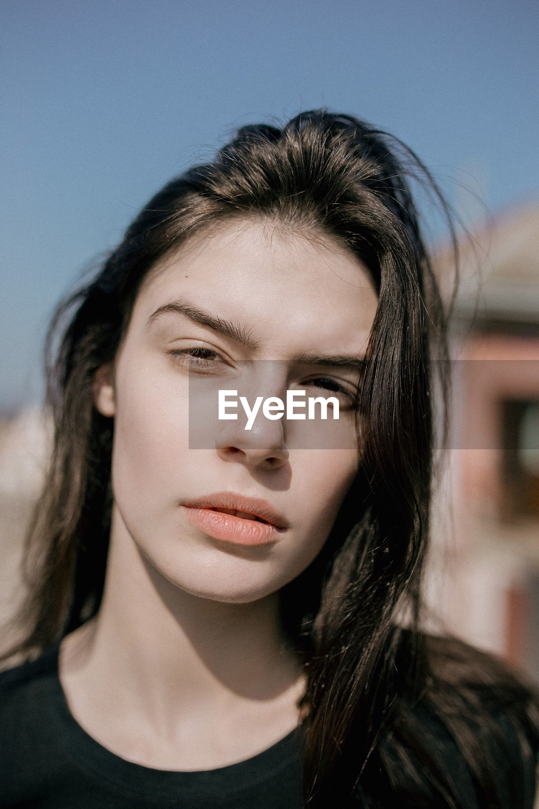 headshot, portrait, one person, front view, hair, hairstyle, lifestyles, young adult, leisure activity, focus on foreground, beauty, close-up, long hair, real people, beautiful woman, young women, looking at camera, casual clothing, contemplation, human face, teenager