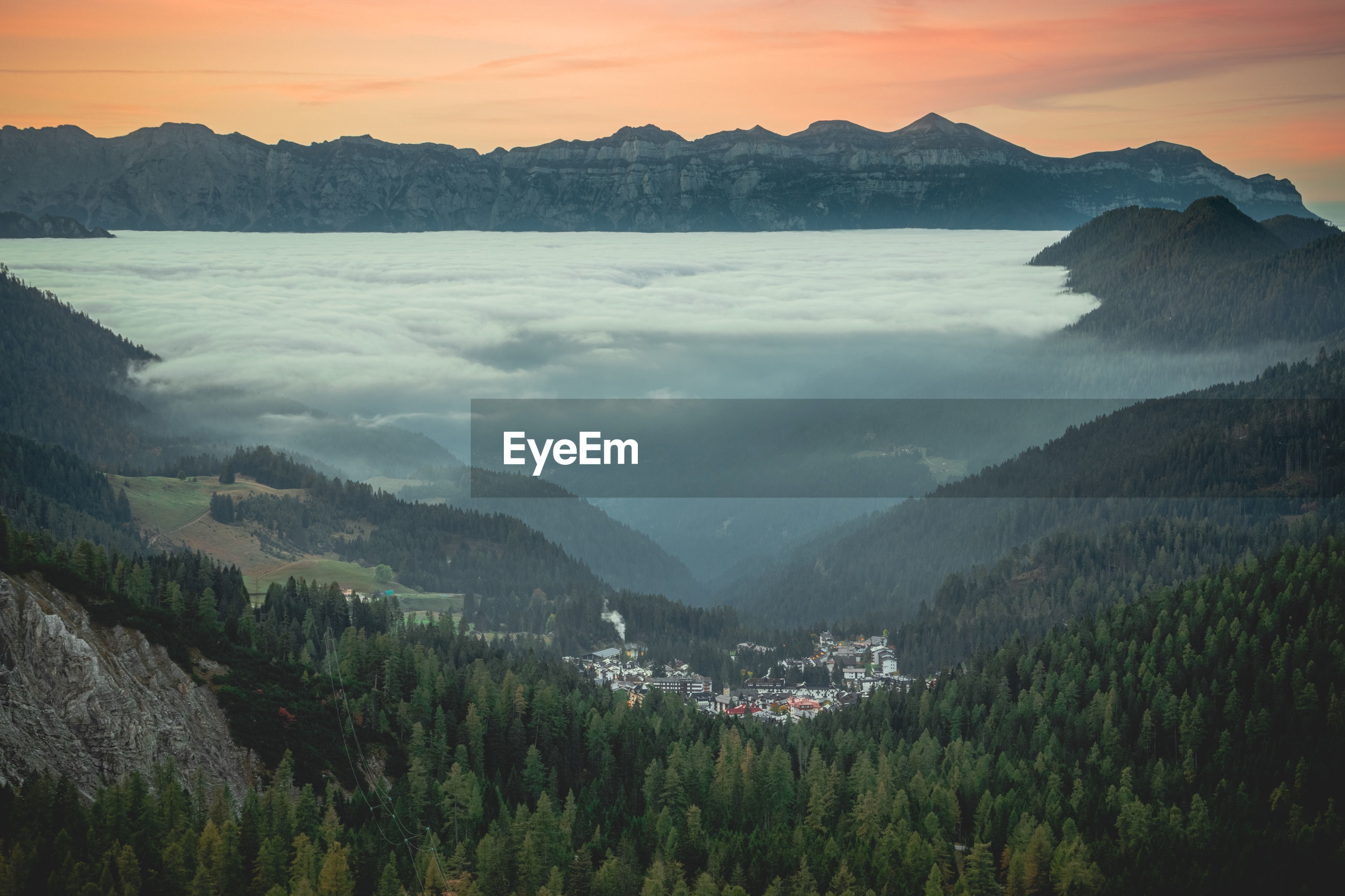 High angle view of trees and mountains against sky during sunrise
