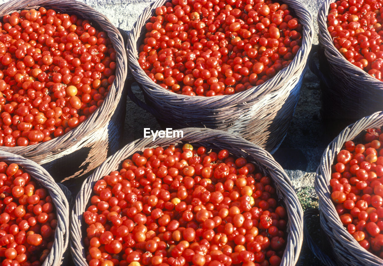 Close-Up Of Tomatoes In Wicker Baskets At Market